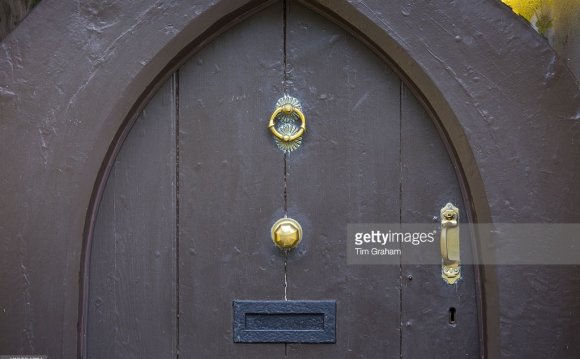 Wooden front door with brass