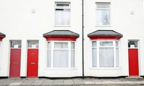 Red doors on leasing properties of refugees in Middlesborough.